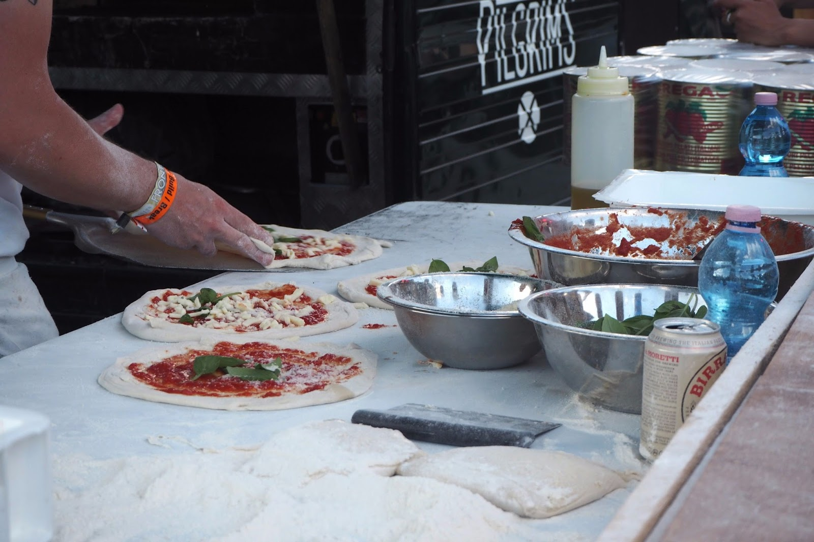Pizzas being made