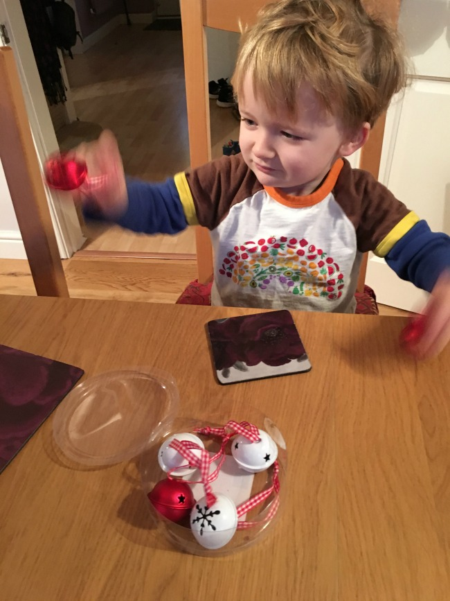 Mud-and-Music-toddler-with-Christmas-bells