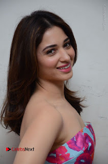 Actress Tamanna Latest Images in Floral Short Dress at Okkadochadu Movie Promotions  0115.JPG