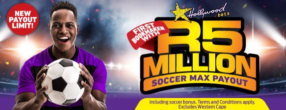 Soccer Player Holds Soccer Ball