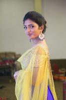 Actress Eesha in Yellow Choli Blue Ghagra at Darshakudu music launch 035.JPG