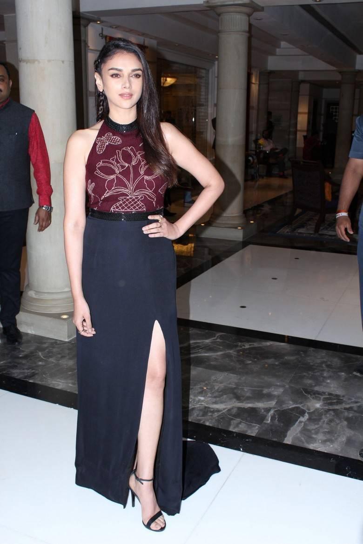 Actress Aditi Rao Long Hair Stills In Maroon Top