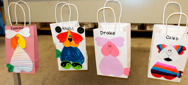 Puppy Valentine bags. My class of first graders made these super cute bags. I've included the template so you can make one too! #gradeonederful #valentinebags #valentinesforkids