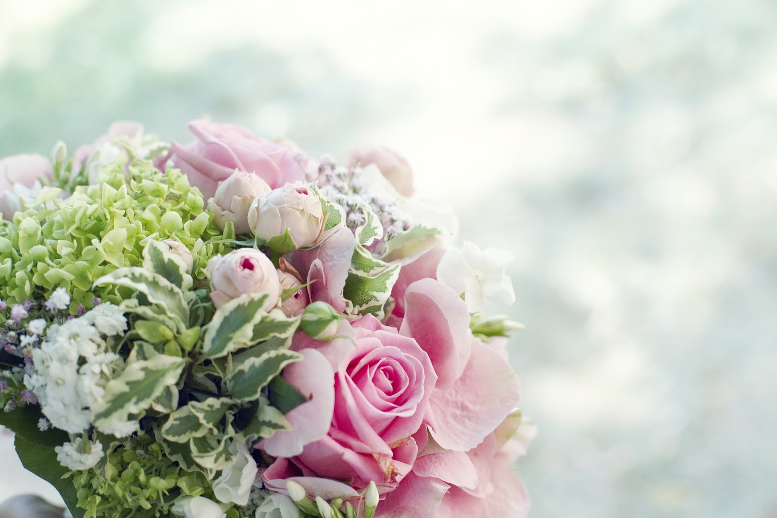 Wedding Bouquet for pink flowers with green leaves