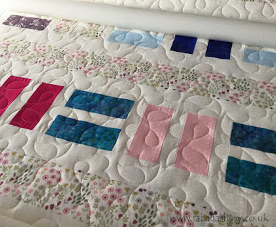 Quilt by Joan, quilted by Fabadashery Long Arm Quilting