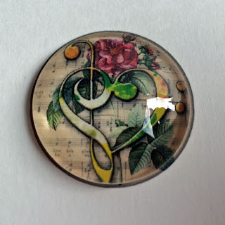 Finished photo glass cabochon still on larger piece of paper