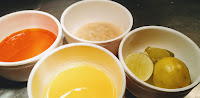 Oil, Red Chilly Paste ginger garlic paste, lemon in small bowl