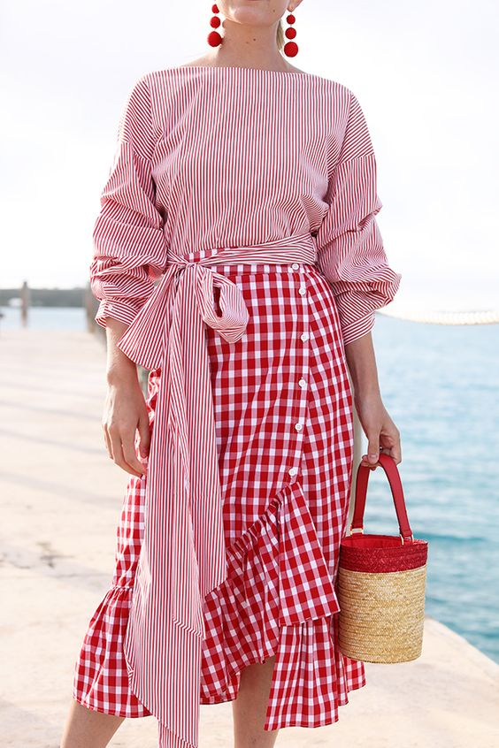 blaire eadey wearing all red outfit red ruffle gingham skirt red pinstripe tie top and basket bag
