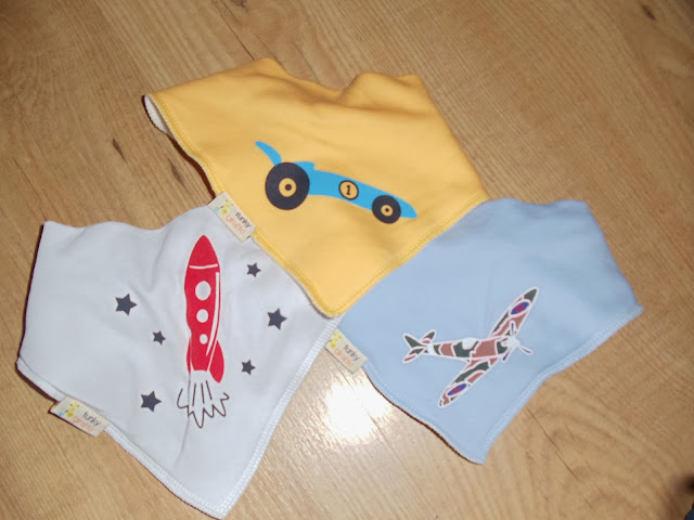 3 children's bibs with a rocket, car and plane on,