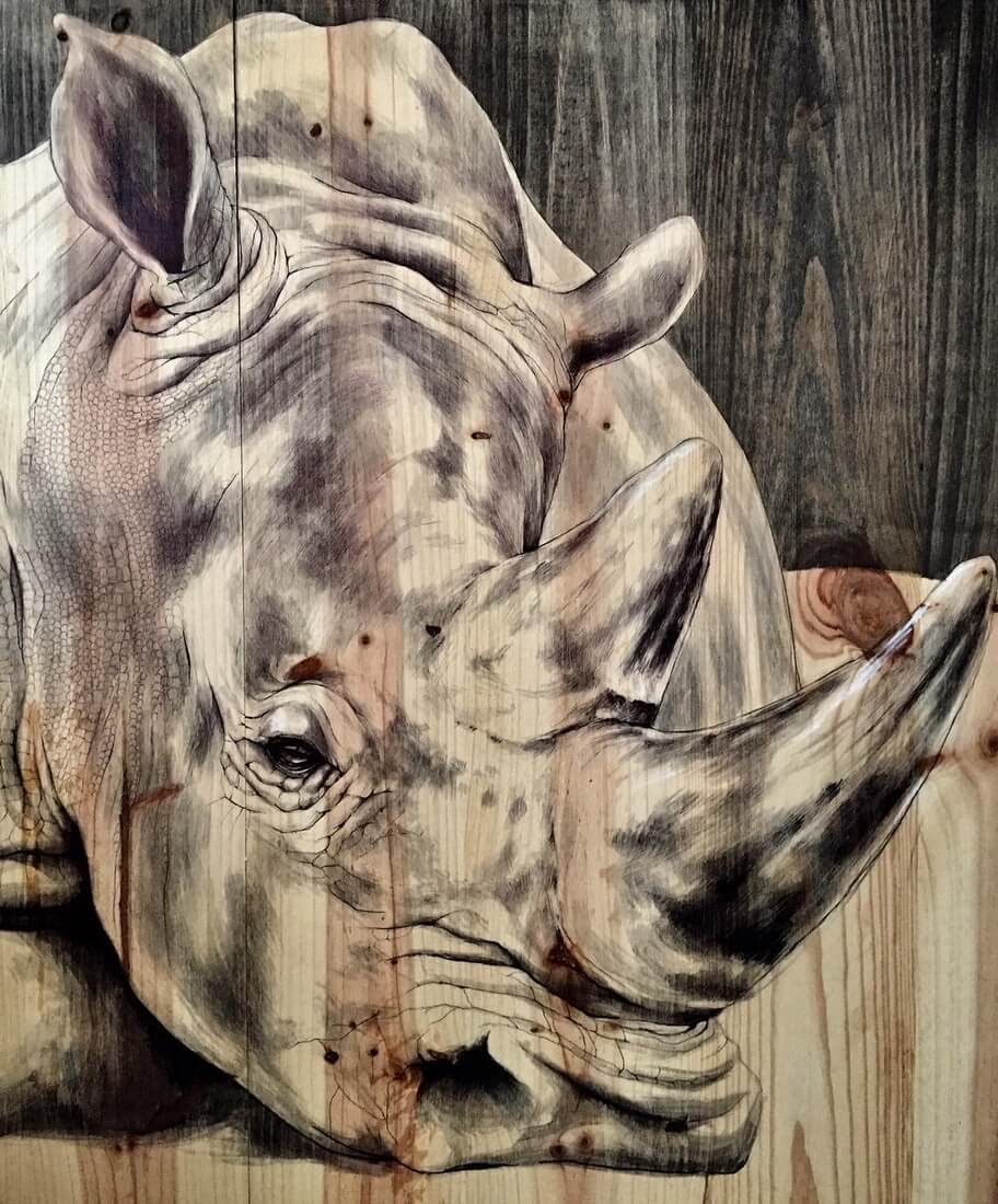 08-Rhino-Rhinoceros-Martina-Billi-Animal-Drawings-on-Recycled-Wooden-Planks-www-designstack-co