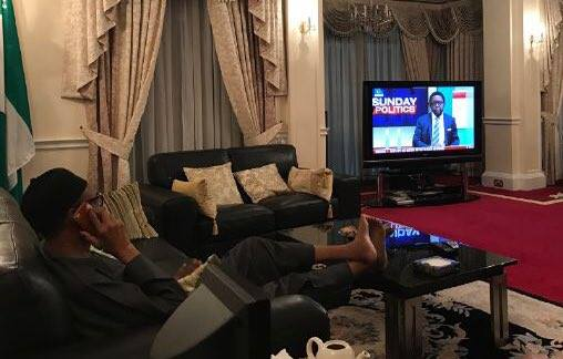 Nigerian President Muhammadu Buhari shares a photo of himself watching Nigerian TV station from vacation in London