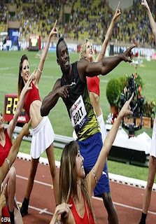 Photos: After Winning Monaco Diamond League, Usain Bolt Makes His Signature Pose With Cheerleaders