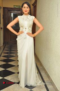 Actress Pragya Jaiswal Stills in Beautiful White Dress at turodu Audio Launch  0057.JPG
