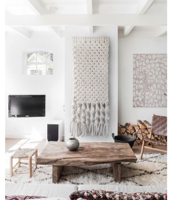 rustic, nordic interior with a large macrame and moroccan rug