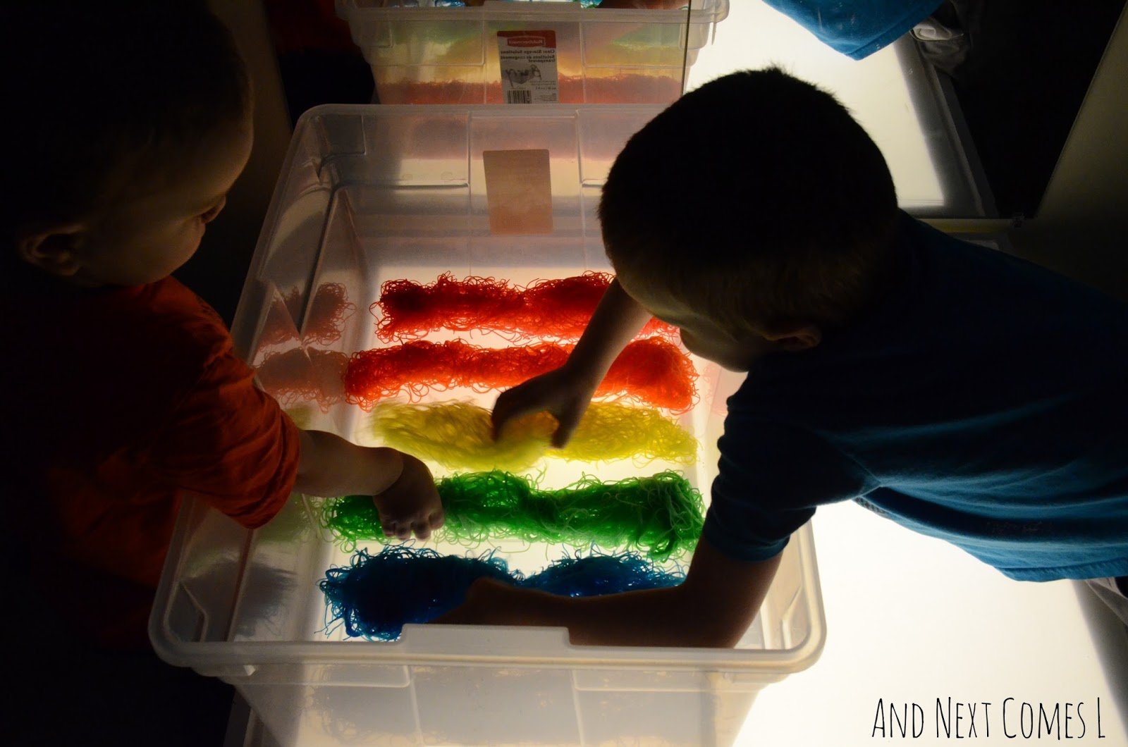 Checking out the rainbow rice noodles on the light table from And Next Comes L