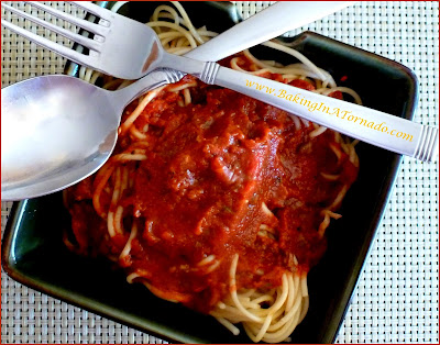 Hearty Meat Sauce for a hot and filling spaghetti dinner. Developed to have a bit of a kick to it, but the heat can easily be toned down. This chunky meat sauce can be made stove-top or in a slow cooker. | Recipe developed by www.BakingInATornado.com | #recipe #dinner