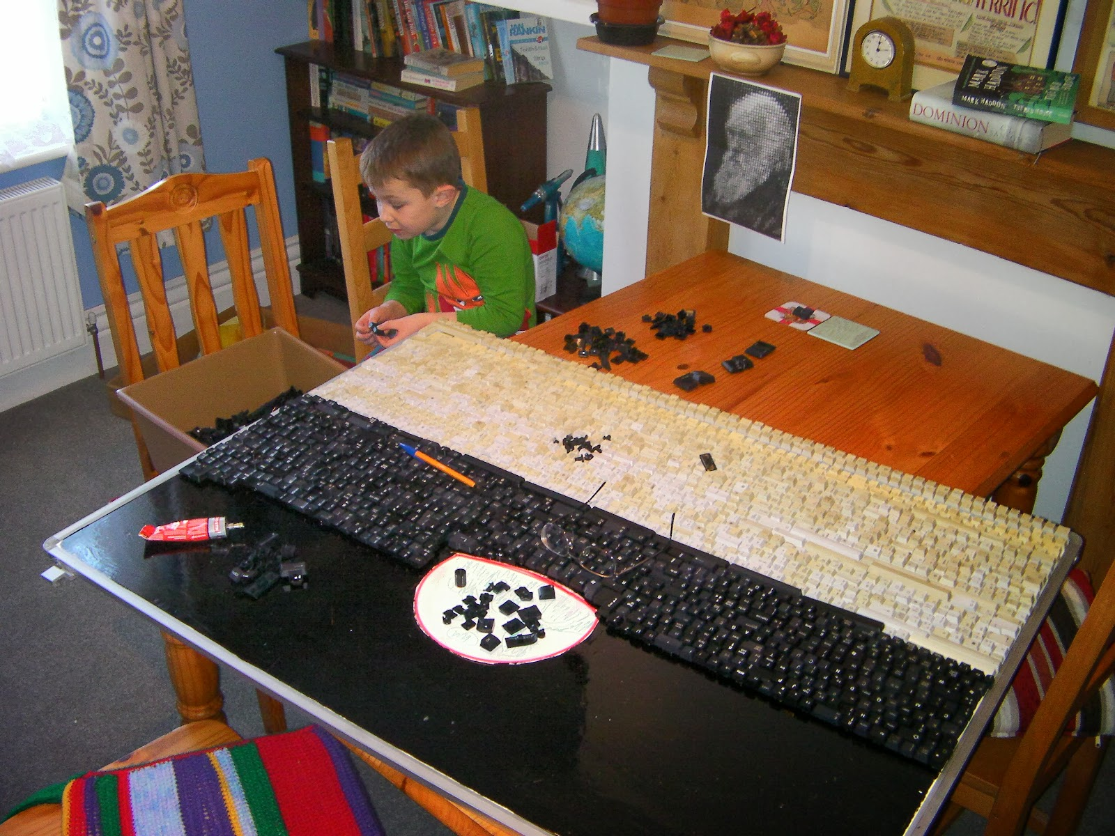 boy with b+q glue and computer keyboard keys