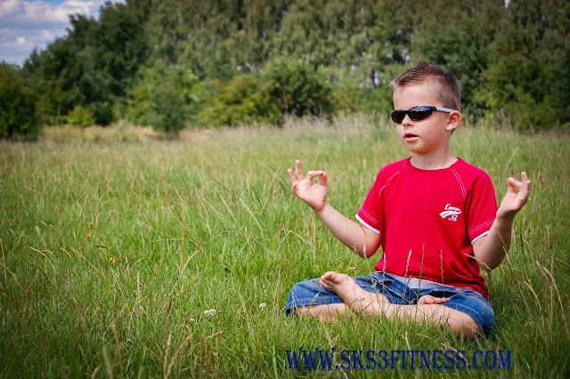 Kid doing Meditation in Gyan Mudra Yoga Mudra