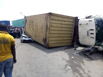 Container Falls On A Car In Mile 2, Kills The Driver - Photos