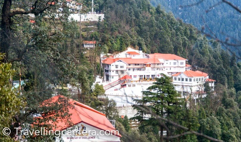 I have been to Dalhousie many times and during last visit, I and Vibha planned to walk around Dalhousie Public School. This beautiful School is located on a huge hill on the road which connected Dalhousie with Khajjiar. This PHOTO JOURNEY shares some photographs of Dalhousie Public School in Himachal Pradesh. Above photograph gives a quick glimpse of the campus, but it's not the whole thing. Dalhousie Public School is spread over two hills around the town. This is one of the most popular boarding schools in Himachal Pradesh.Lot of kids from various parts of the country and abroad come here for studies. It definitely a great place to study and have fun around snow covered hills. It's quite peaceful place and weather is just awesome. When cities like Delhi are hot with 40-45 degrees, these kids wear their jackets in Dalhouise. Instead of Summer vacations, the school is closed for 2 months during winters. Dalhousie Public School has recently started 11th and 12th classes as well. Earlier it was a high school. This was unbelievable. A MIG is installed in the campus of Dalhousie Public School. I don't know much about why and how, but it really sounds interesting :). We were staying in the house you see in above photograph and we wanted to come to this place to ensure that it's real and not a model. Walking up till the student hotels, we realized that even 5 year old kids are also staying here without their parents. This was hard to imagine for us, but it seems that they enjoy being here with their friends and caring staff. Above photograph shows the main campus of the school with all offices and class-rooms. This is first building you see when coming from Dalhousie Town towards Khajjiar. There is approximately 1 km stretch of Dalhousie-Khajjiar road, which is beautifully maintained by Dalhousie Public School. Due to snowfall all the flowering plants had died but staff was actively working to make these pot happy with new plants. Principal's residence @ Dalhousie Public School. Like the whole campus of the school, residences of teachers and principal was quite nice. Here is a view of Ravi river from Teacher's residences. Ravi  river looks stunning on a sunny day. The day we visited Dalhouise, it was rainy and cloudy.