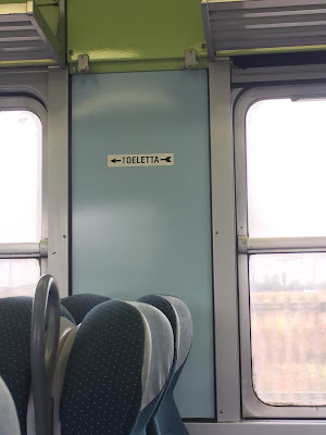 Toilet sign on a train.