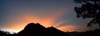sunrise rays over mountain