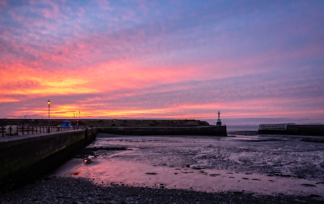 Photo of a wider view of Maryport basin at sunset
