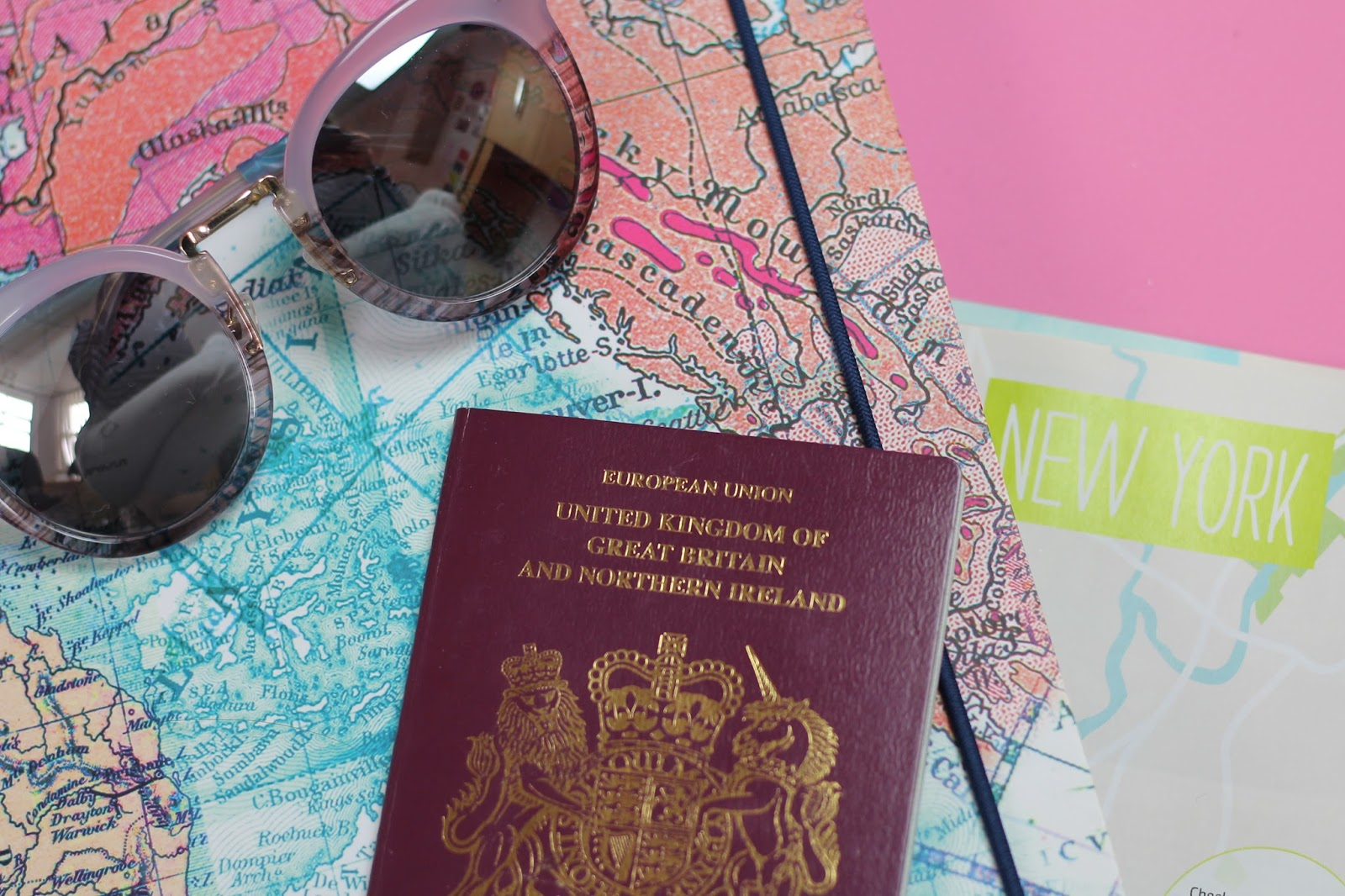 how we planned our USA road trip: map print notebook, passport, travel brochure and Stella and dot pastel pink sunglasses