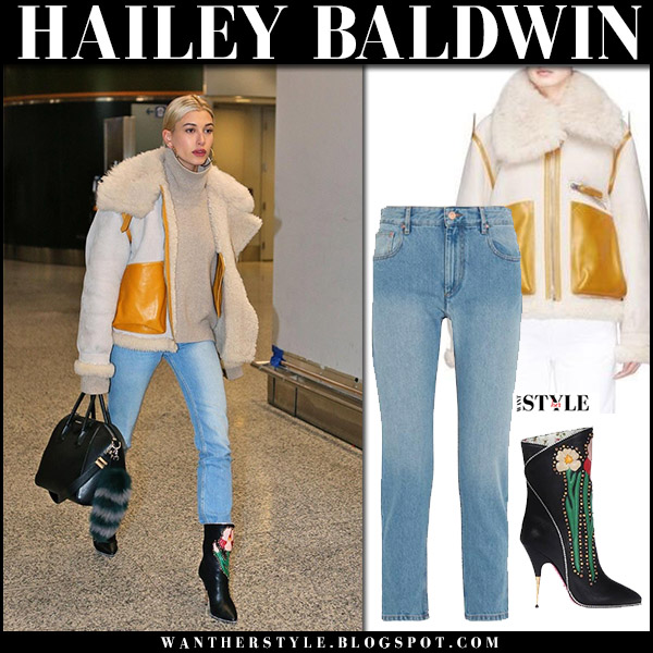 Hailey Baldwin in ecru shearling jacket acne lore, jeans and black ankle boots gucci airport style december 8