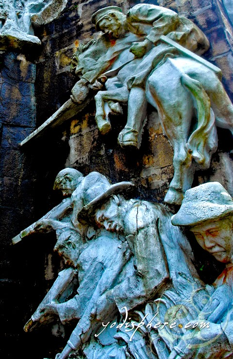 Scultures at the base of the cross in Mt. Samat National Shrine