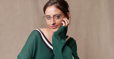 K'Mich Wedding - wedding planning - eye wear - wire frames with structural outlines - woman in green sweater wearing architectural design glasses