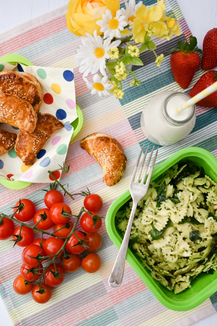 Easy Vegan Mini Spinach & Cream Cheese Puff Parcels in a picnic spread with pasta salad and cherry tomatoes