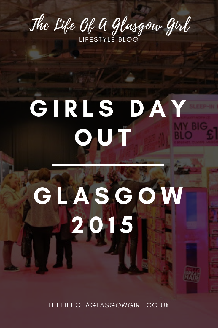 Pinterest graphic for blog post on Girls Day out show in Glasgow 2015. A photo of the venue with lots of people walking through, there is a pink carpet and a pink booth that is selling some hair products