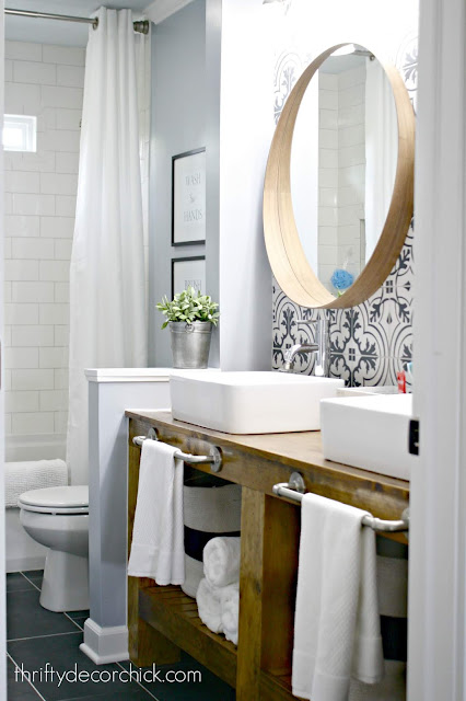 DIY bathroom vanity with black and white tile wall