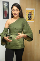 Pragya Jaiswal in a single Sleeves Off Shoulder Green Top Black Leggings promoting JJN Movie at Radio City 10.08.2017 106.JPG