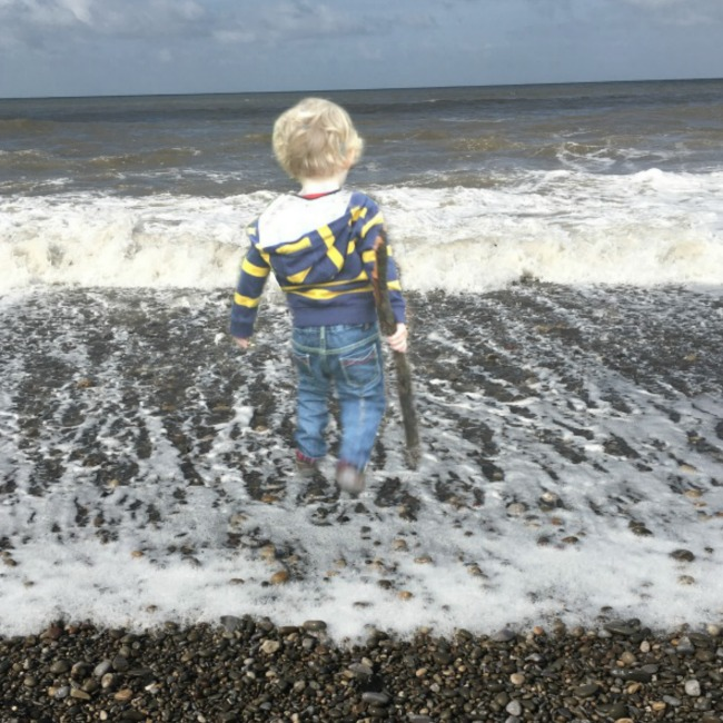 combined-picture-of-toddler-now-standing-in-the-sea