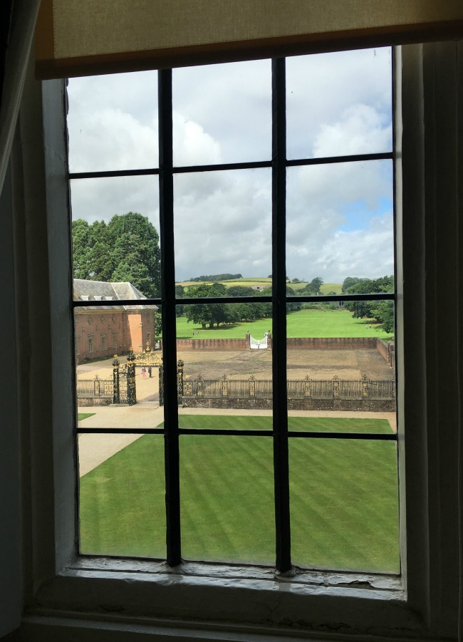 view-through-window-at-tredegar-house-looking-towards-stables-and-parkland