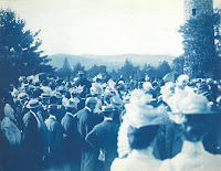A group of men and women standing near Bartlett Tower.