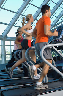 Joggers on treadmills at a gym