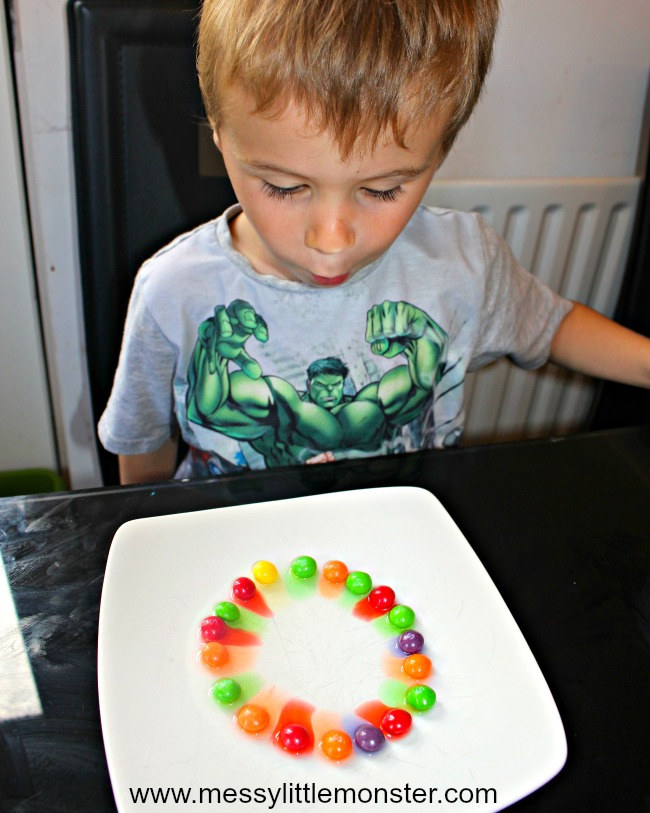 Rainbow skittles in a classic kids science experiment loved by toddlers, preschoolers and older kids.