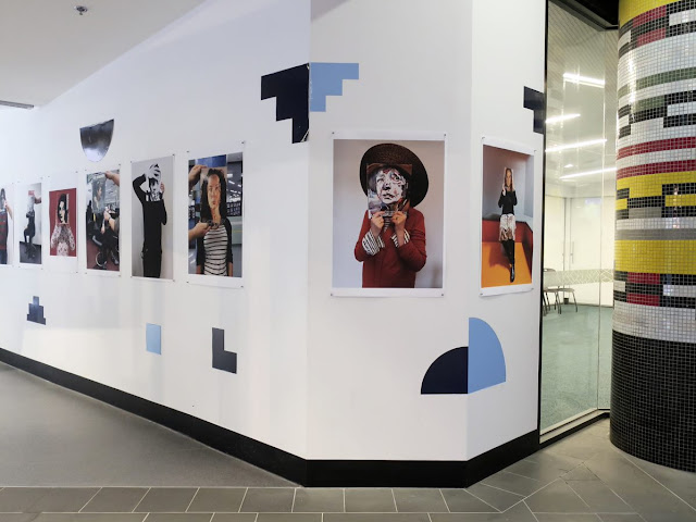 Image of art exhibition items on the wall