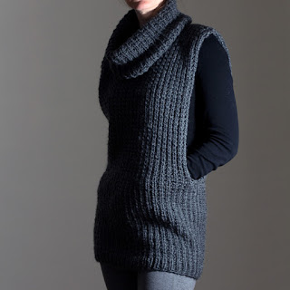 Large stitch accent pullover with deep, open sleeves and a large cowl.