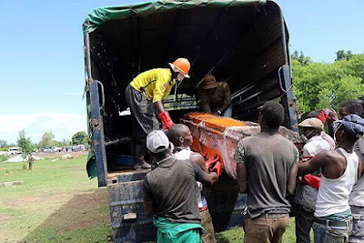 Photos: Drama as Kenyan youths exhume body 2months after being buried