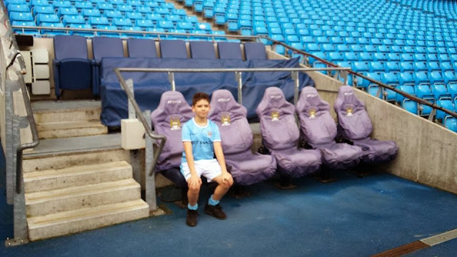 Young fan in the dug out at The Etihad
