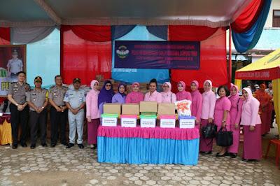 Polda Lampung Salurkan Sembako dan Pengobatan Gratis Bagi Warga Korban Banjir Sukadana