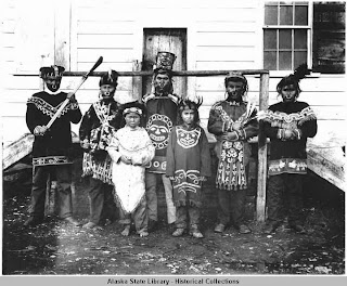 Group of people wearing regalia.