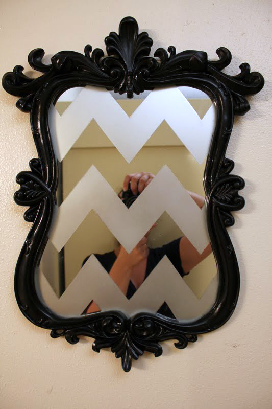 A mirror with chevrons etched into the surface