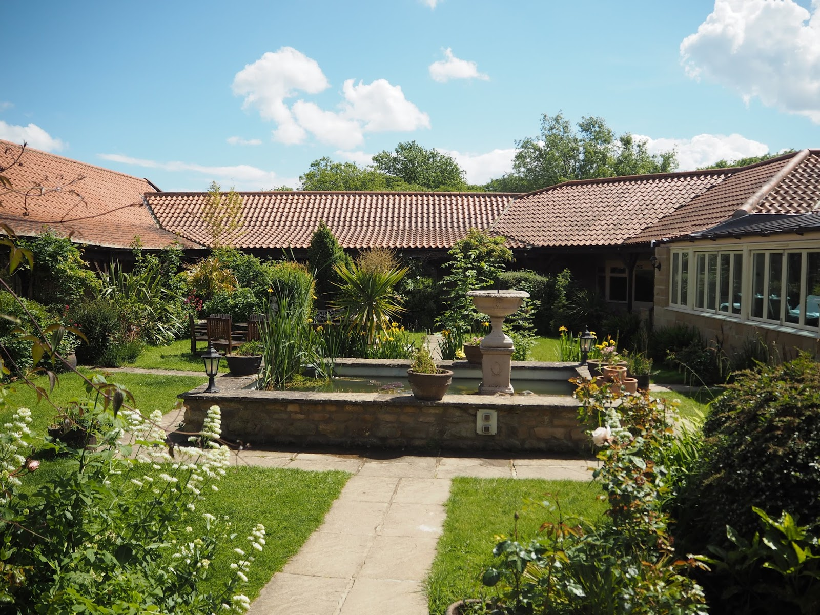 Courtyard gardens Ox Pasture Hall Country Hotel, Scarborough, Yorkshire, romantic hotel near beach in Scarborough