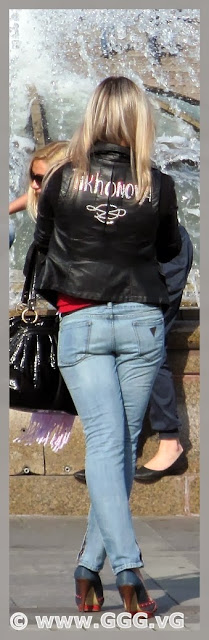 Girl wearing blue jeans on the street