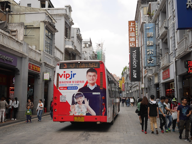 bus with advertisement featuring Yao Ming